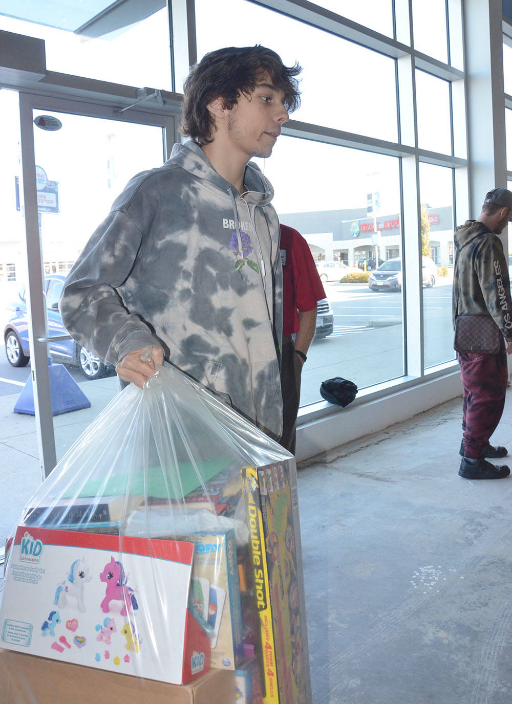 Anthony Wideman and seven other students from Vanguard helped set up the Langley Christmas Bureau which opens for the season on Nov. 4. (Heather Colpitts/Langley Advance Times)