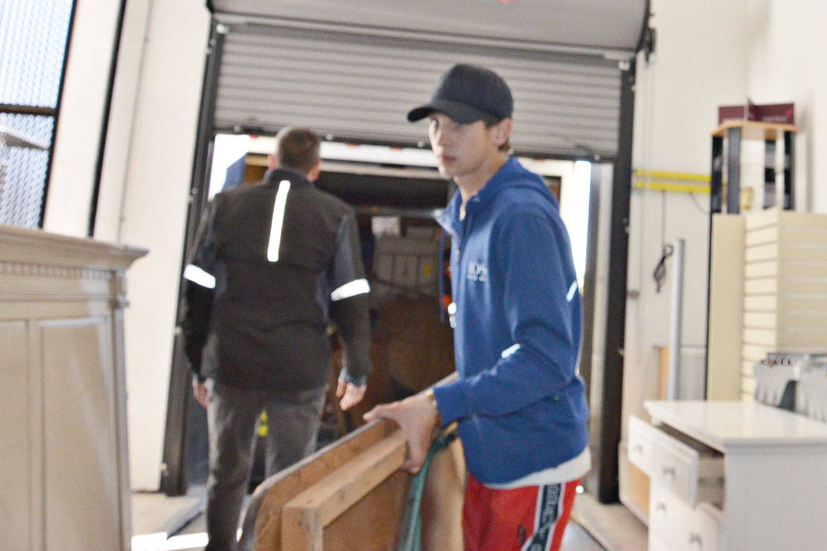 Before the Langley Christmas Bureau can make Christmas merry for local disadvantaged children, it has to be set up. Items are taken from storage and set up by people such as Vanguard student Austin Wideman. (Heather Colpitts/Langley Advance Times)