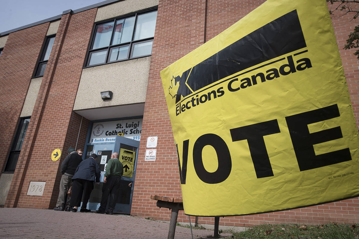 Voters enter the polling station at St. Luigi Catholic School during election day in Toronto on Monday, October 21, 2019. Elections Canada has released some preliminary numbers from Canada's 43rd general election is that help tell the story of the vote, beyond the final results. THE CANADIAN PRESS/ Tijana Martin
