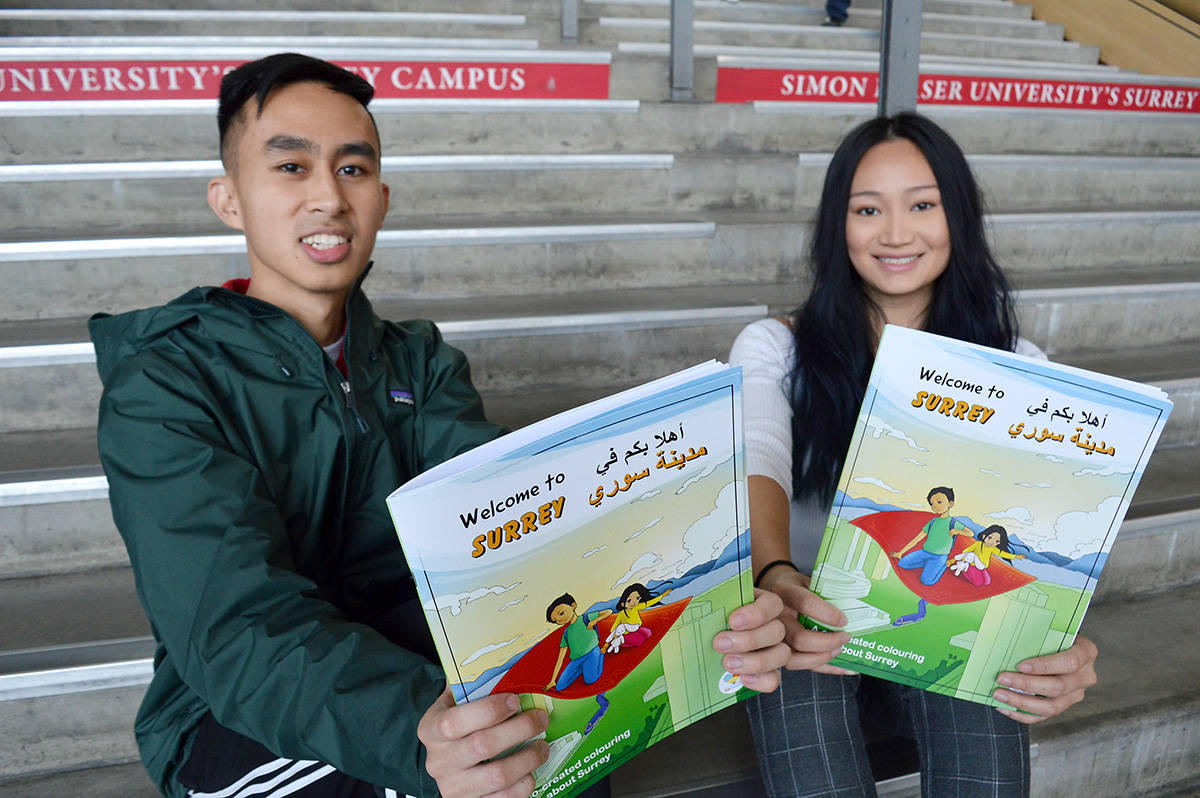 "Renmart Buhay (left) and Alanah Lam are two of four SFU students who worked to create a ""Welcome to Surrey"" colouring book for refugee families. (Photo: Amy Reid)"