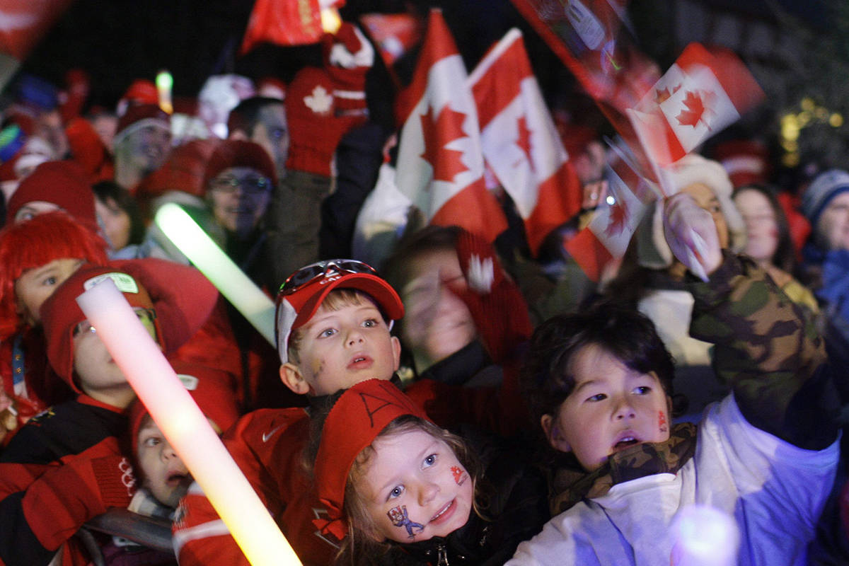 Children celebrate the arrival of the Vancouver 2010 Olympic torch to Whistler, British Columbia, Friday, Jan. 5, 2010. (AP Photo/Anja Niedringhaus)