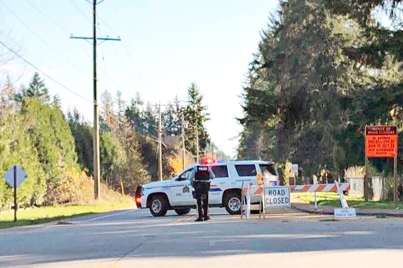 Police blocked off 56th Avenue east of 240th Street later Monday after officers 'swarmed' the area to pursue a fleeing SUV, according to one eyewitness. (Photo by Alison Birkhiem Linden)