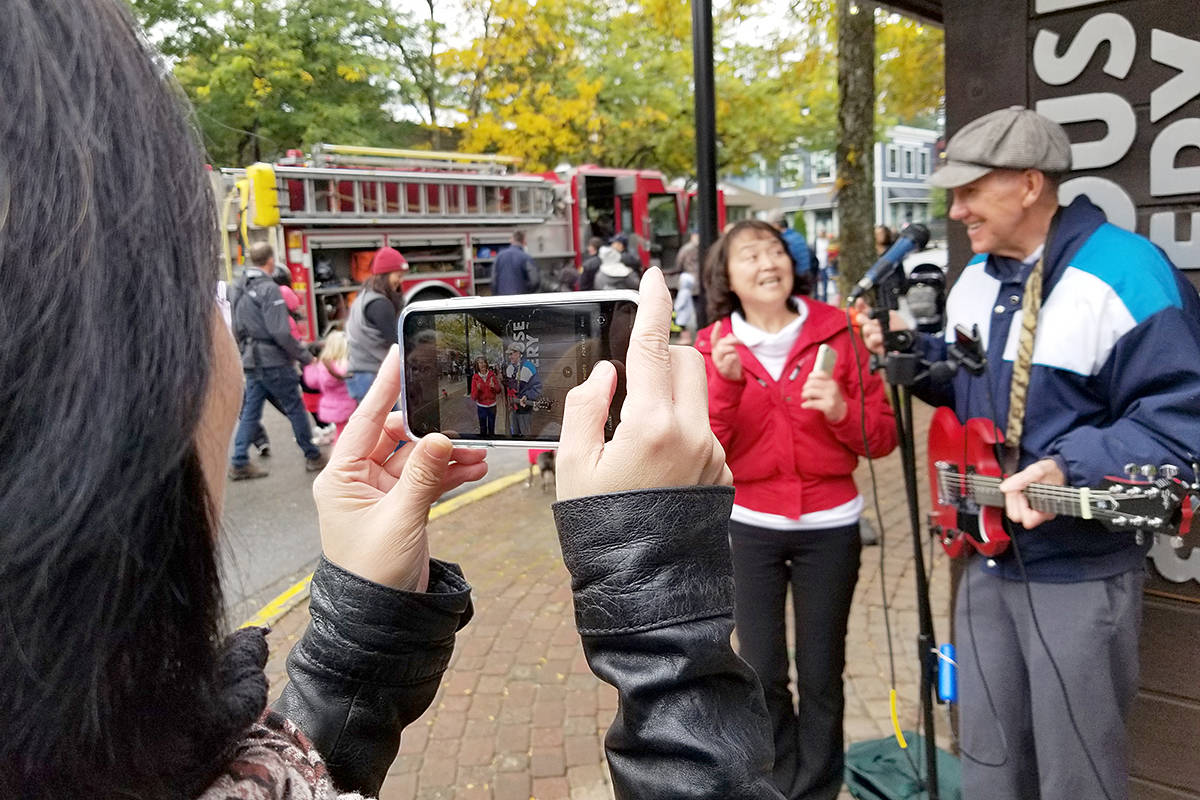 Murray Cameron attracted attention when the 71-year-old busker sang a song in Mandarin during the Oct. 12th Cranberry Festival. He's been busking for 20 years. (Dan Ferguson/Langley Advance Times)