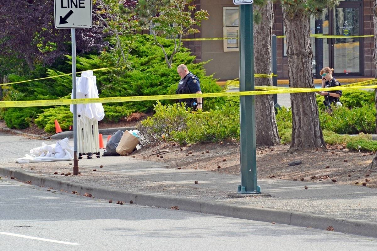 Investigators at the scene where South Surrey resident Paul Prestbakmo died of stab wounds early Aug. 16. Police confirmed Wednesday a link between an assault hours earlier on an elderly White Rock man and Prestbakmo's death. (Tracy Holmes photo)