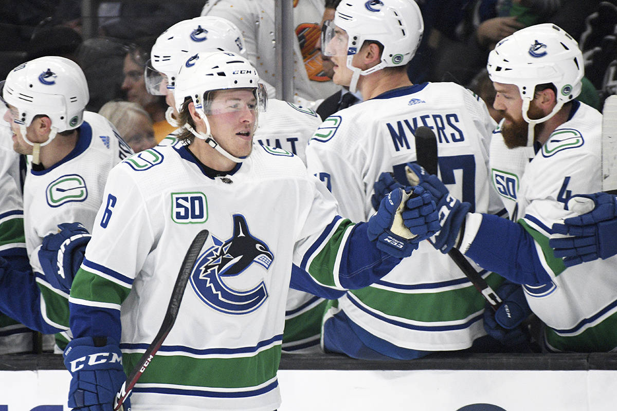 Vancouver Canucks right wing Brock Boeser, front, is congratulated after scoring against the Los Angeles Kings during the second period of an NHL hockey game Wednesday, Oct. 30, 2019, in Los Angeles. (AP Photo/Michael Owen Baker)