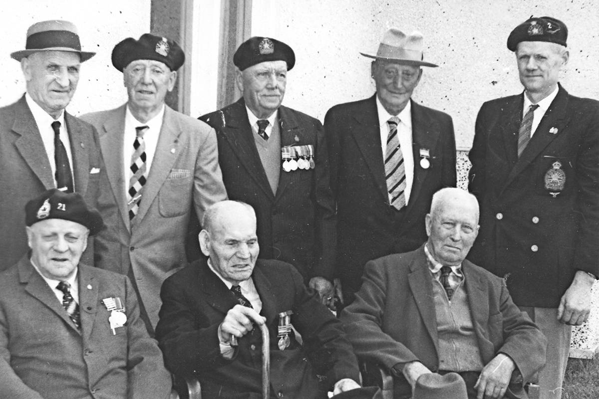 A photo from the Langley Advance Times archives in the 1950s or 1960s showed a gathering of veterans of the Boer War, with the participants identified, back row from left to right: Ben Williams, John Simpson, Sam Cudman, Walter Smallwood, Imes or Ines Alfast; seated from left to right: George Bulcher, James Musgrave, and Allan Turnbull.                                A photo from the Langley Advance Times archives in the 1950s or 1960s showed a gathering of veterans of the Boer War, with the participants identified, back row from left to right: Ben Williams, John Simpson, Sam Cudman, Walter Smallwood, Imes or Ines Alfast; seated from left to right: George Bulcher, James Musgrave, and Allan Turnbull.