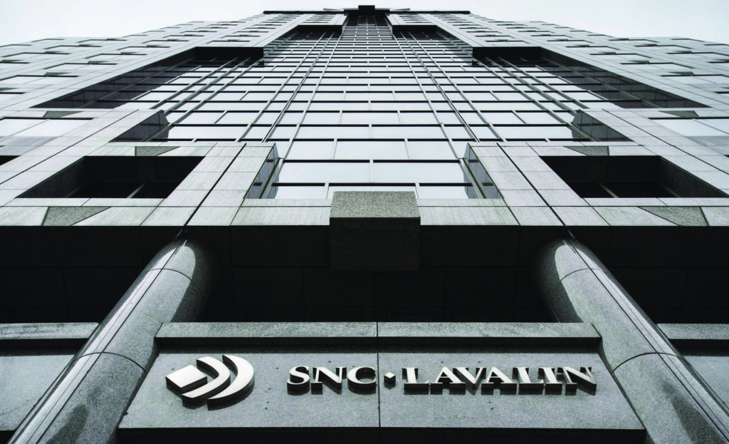 on November 6, 2014 in Montreal. SNC-Lavalin Group is cutting its quarterly dividend for shareholders by 80 per cent as the troubled construction and engineering company grapples with a $2.12 billion net loss in its second quarter. THE CANADIAN PRESS/Paul Chiasson