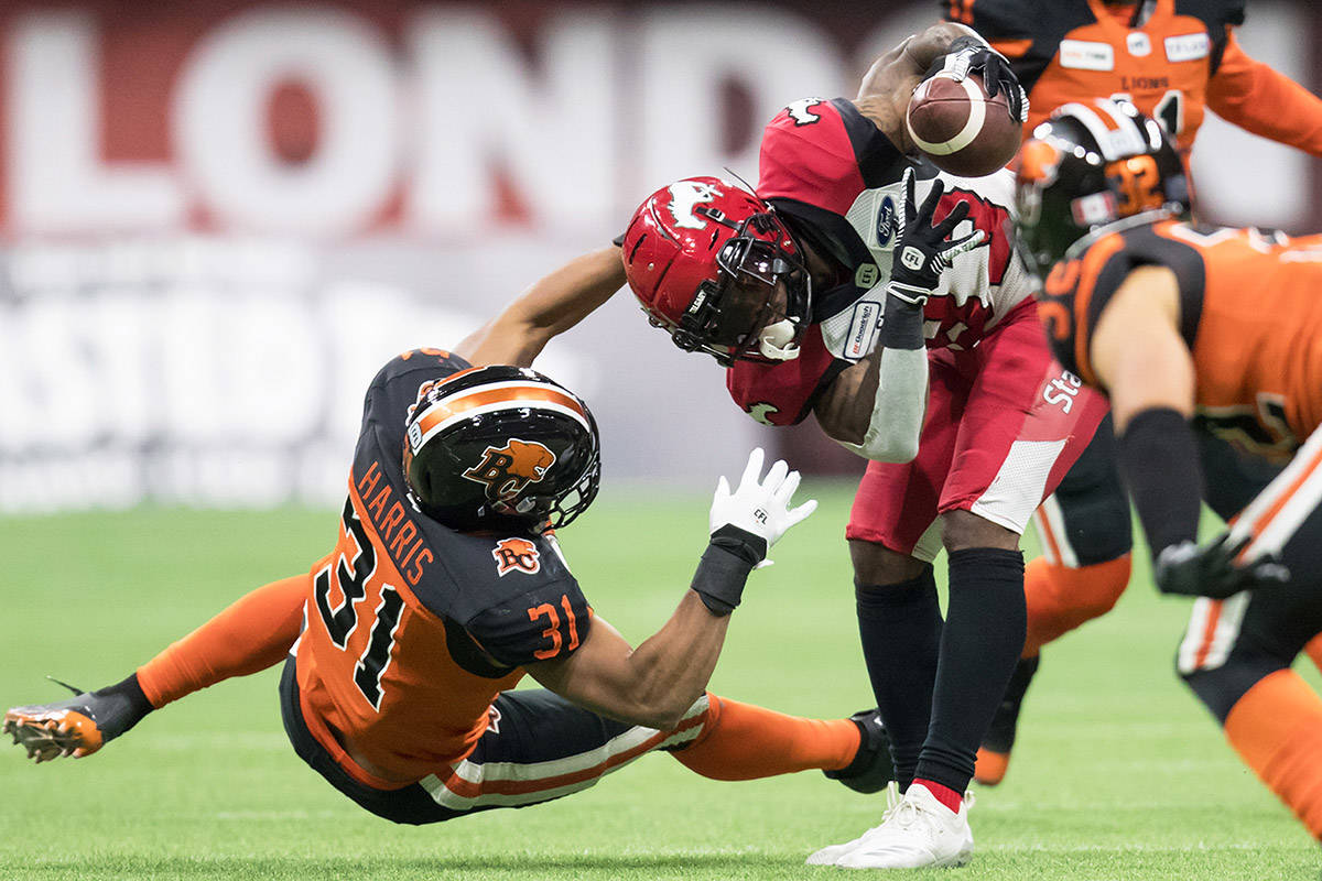 B.C. Lions' Maleki Harris (31) attempts to grab Calgary Stampeders' Josh Huff (83) but misses the tackle during first half CFL football action in Vancouver, Saturday, Nov. 2, 2019. THE CANADIAN PRESS/Darryl Dyck