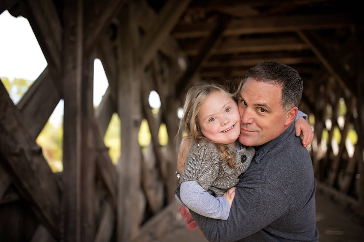 Ed Casagrande holds his daughter Emma in this undated handout image. Casagrande, chair of the Canadian Down Syndrome Society, is hoping the society's partnership with Google will help people like his six-year-old daughter Emma access improved voice-recognition technology. The society is encouraging those with Down Syndrome to record phrases on its Project Understood site to add to the tech giant's database aimed at creating voice-recognition technology that can understand people with various speech impairments. THE CANADIAN PRESS/HO-Hillier Photography *MANDATORY CREDIT*