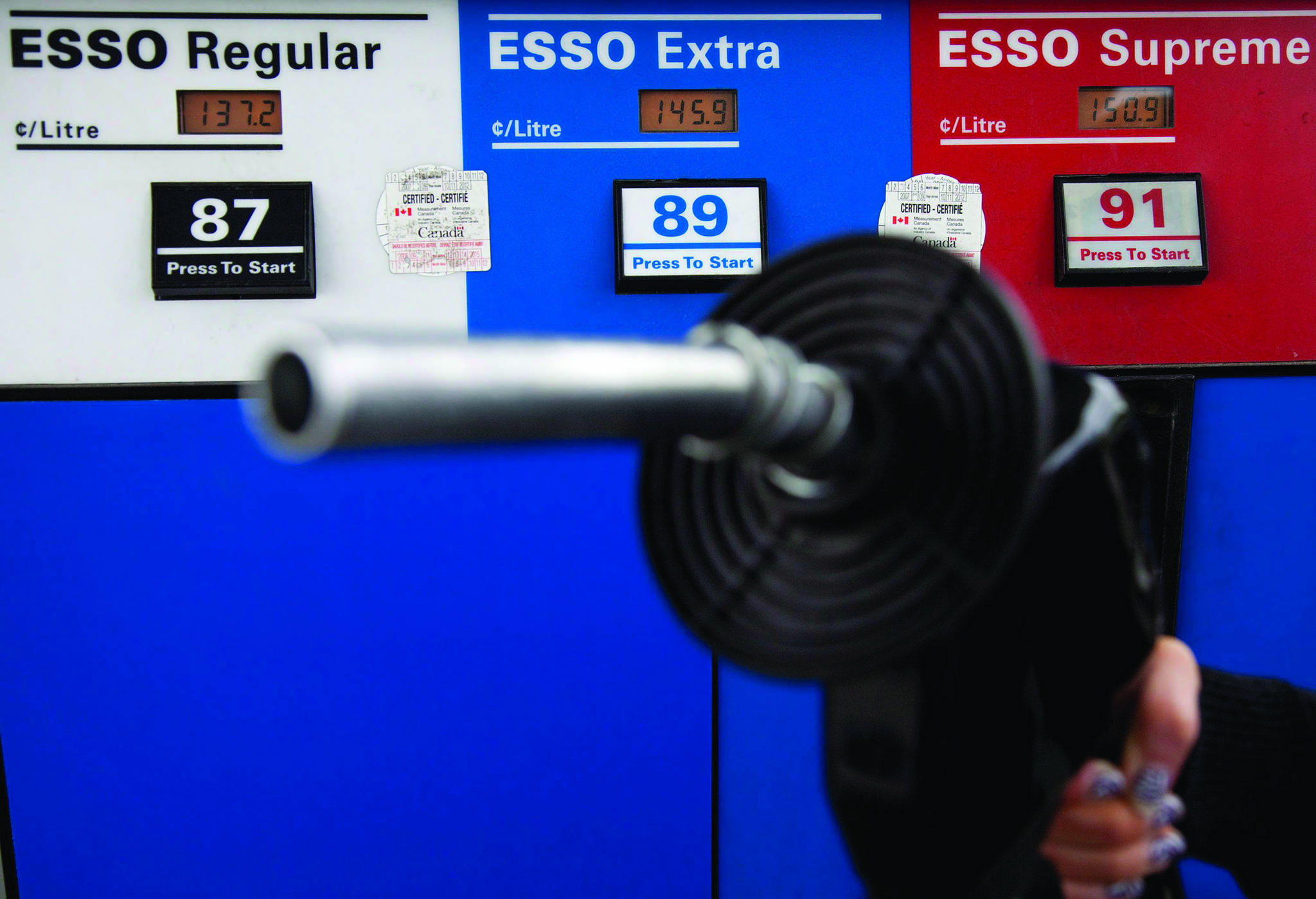 Gas prices are displayed as a motorist prepares to pump gas at a station in North Vancouver on May 10, 2011. Shares in Parkland Fuel Corp., Canada's largest independent fuel marketer, are up after it increased its adjusted 2019 earnings guidance on the back of strong third-quarter results. The Calgary-based company says it now expects its adjusted earnings before interest, taxation, depreciation and amortization will be $75 million higher than previously forecast, at $1.24 billion. The company which sells gasoline and diesel under brands including Fas Gas, Chevron, Esso, Ultramar and Pioneer, and operates On The Run convenience stores, reported third-quarter net earnings of $26 million, down from $49 million in the year-earlier period. THE CANADIAN PRESS/Jonathan Hayward