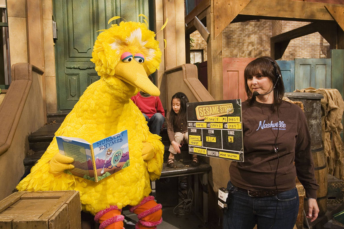 """FILE - This April 10, 2008 file photo shows Lynn Finkel, stage manager for """"Sesame Street,"""" slates a taping with Big Bird, performed by Caroll Spinney, in New York. The popular children's TV show is celebrating its 50th year. (AP Photo/Mark Lennihan, File)"""