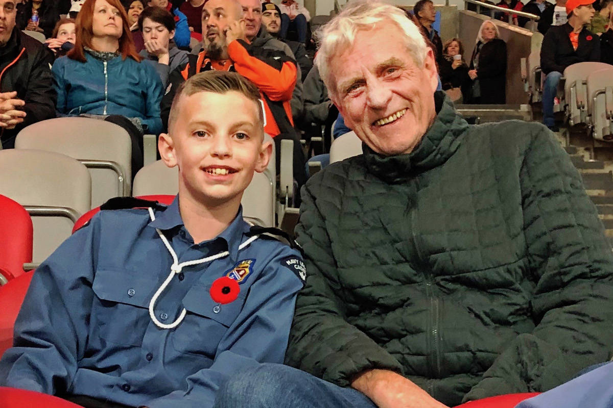 Gavin sat happily with his grandpa Finn Hansen who came to watch his family perform. (Jennifer Ross/Special to the Aldergrove Star)