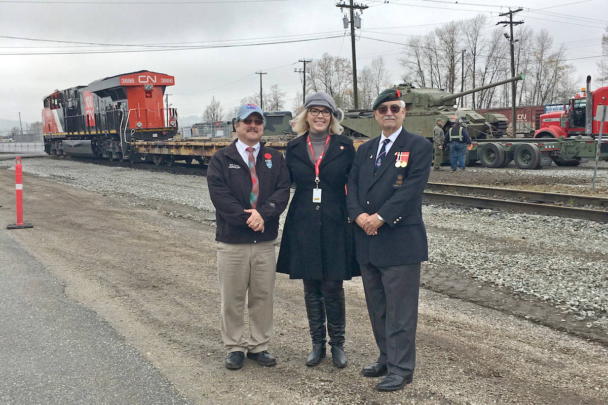The tank was welcomed by (from left) Coun. Bob Long, CN's Joslyn Young, and Major CF Ian Newby. (Special to the Aldergrove Star)