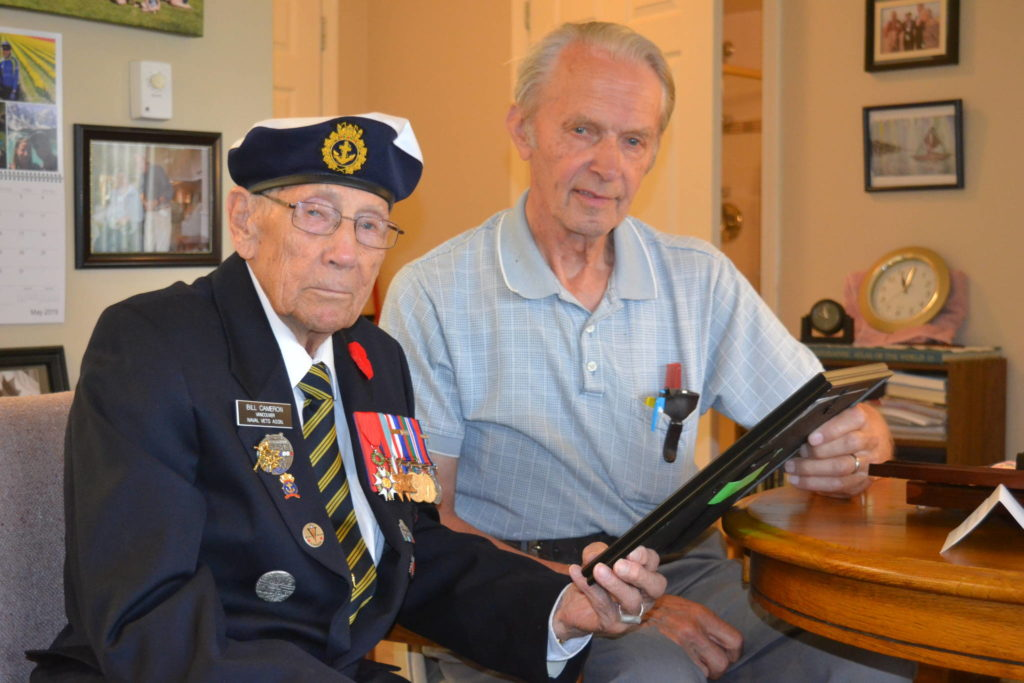 Navy veteran Bill Cameron (left) who was among the crew of a Canadian corvette providing covering fire during the US landing at Omaha Beach will be a special guest, along with neighbor Kees Koster who was a young boy in occupied Holland when D-Day took place. File photo