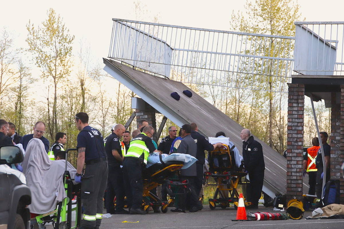 Victims treated at the scene ranged in age from 15 to 83. (Shane MacKichan photo)                                Victims treated at the scene when an Aldergrove deck collapsed on April 19 ranged in age from 15 to 83. (Shane MacKichan photo)