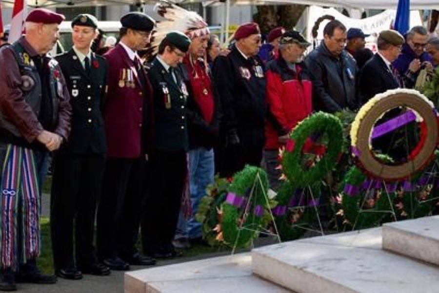 Veterans gather at the Victory Square Cenotaph for a National Aboriginal Veterans Day ceremony in Vancouver, B.C. in 2013. THE CANADIAN PRESS/Darryl Dyck