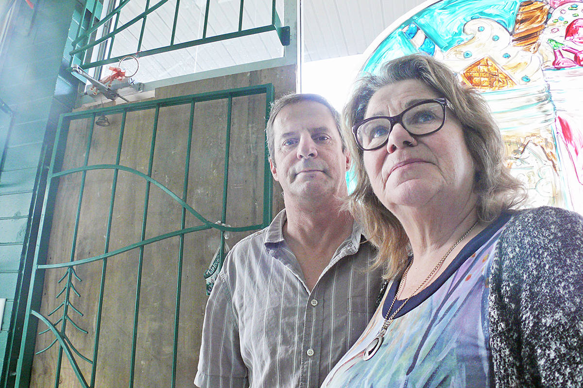 Keith Smythe and Shannon Brogan, the husband and wife who run Brogan's diner in Langley City, seen here in front of the boarded-up door to their deli next door, lost about $15,000 in stolen musical instruments and karaokes equipment during a break-in on the Remembrance Day weekend. (Dan Ferguson/Langley Advance Tines)