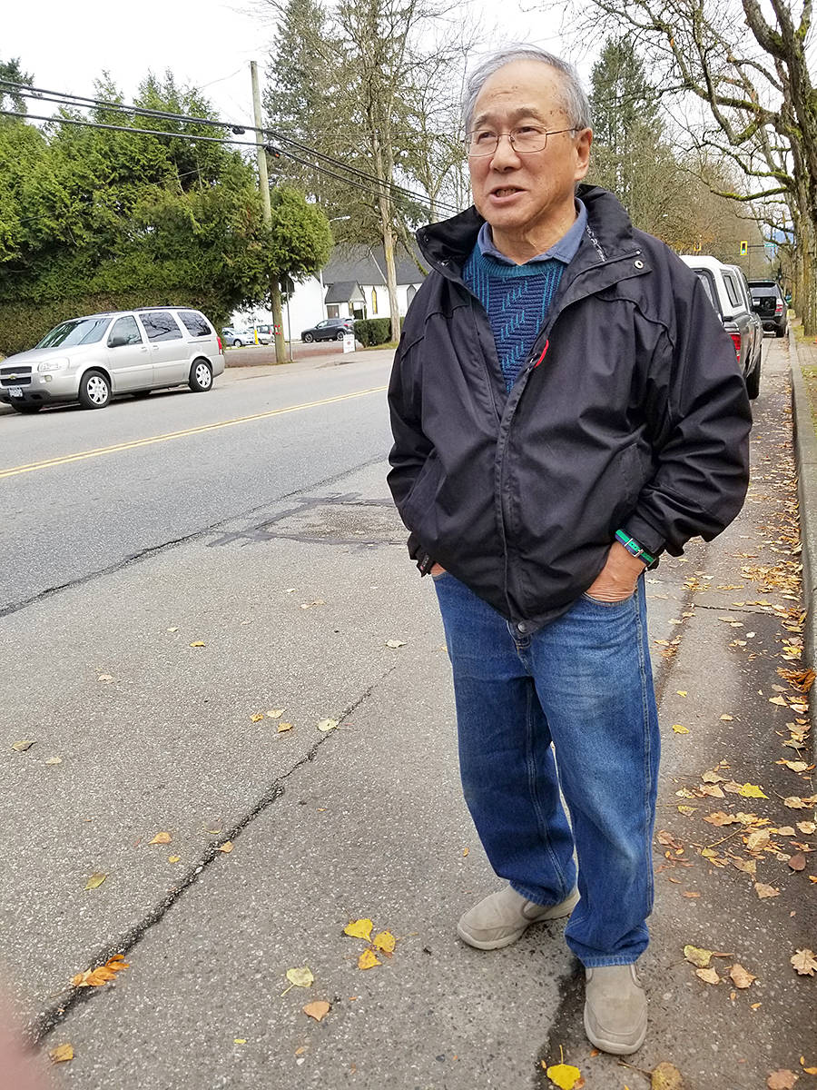Gary Hee, seen here in Fort Langley on Monday, Nov. 11, said he kept trying to wind down his petition for free hospital parking, but people would insist on adding their names, so he kept it going longer than planned. Now, he has sent it to Ottawa. (Dan Ferguson/Langley Advance Times)