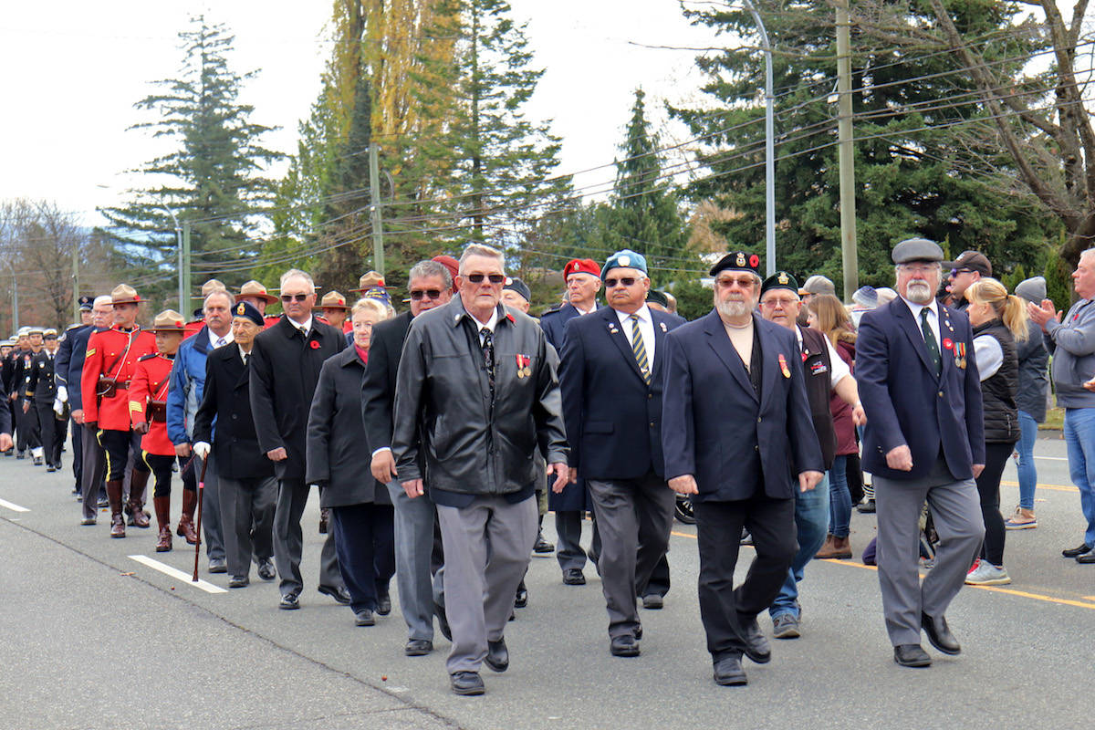 A group of World War veterans marched down Fraser Highway to the Aldergrove cenotaph in front of the Royal Canadian Legion 265. (Sarah Grochowski photo)