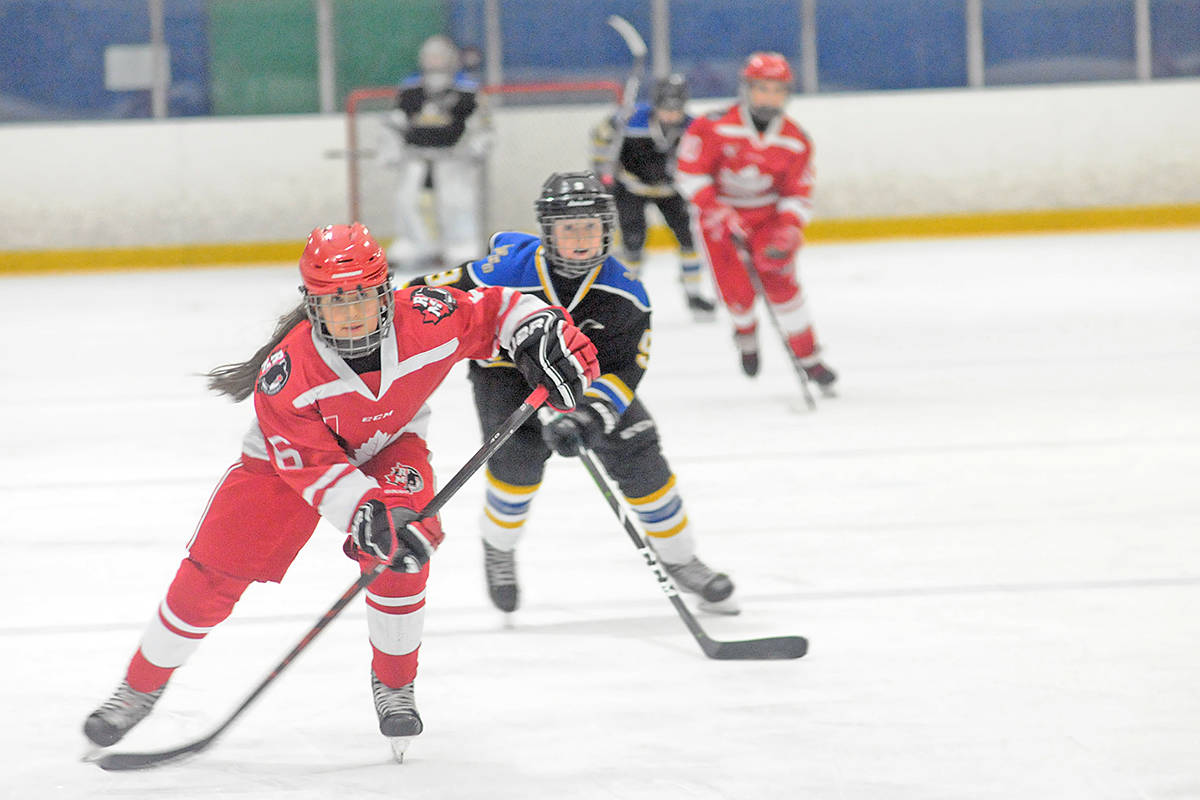 Langley Eagles number 9, Finlay Johnston pursued a Ridge Meadows Rustlers at the Gil Martin Memorial Hockey Tournament at the Langley Sportsplex on Sunday, Nov. 10. It ended in a 3-3 tie. (Dan Ferguson/Langley Advance Times)