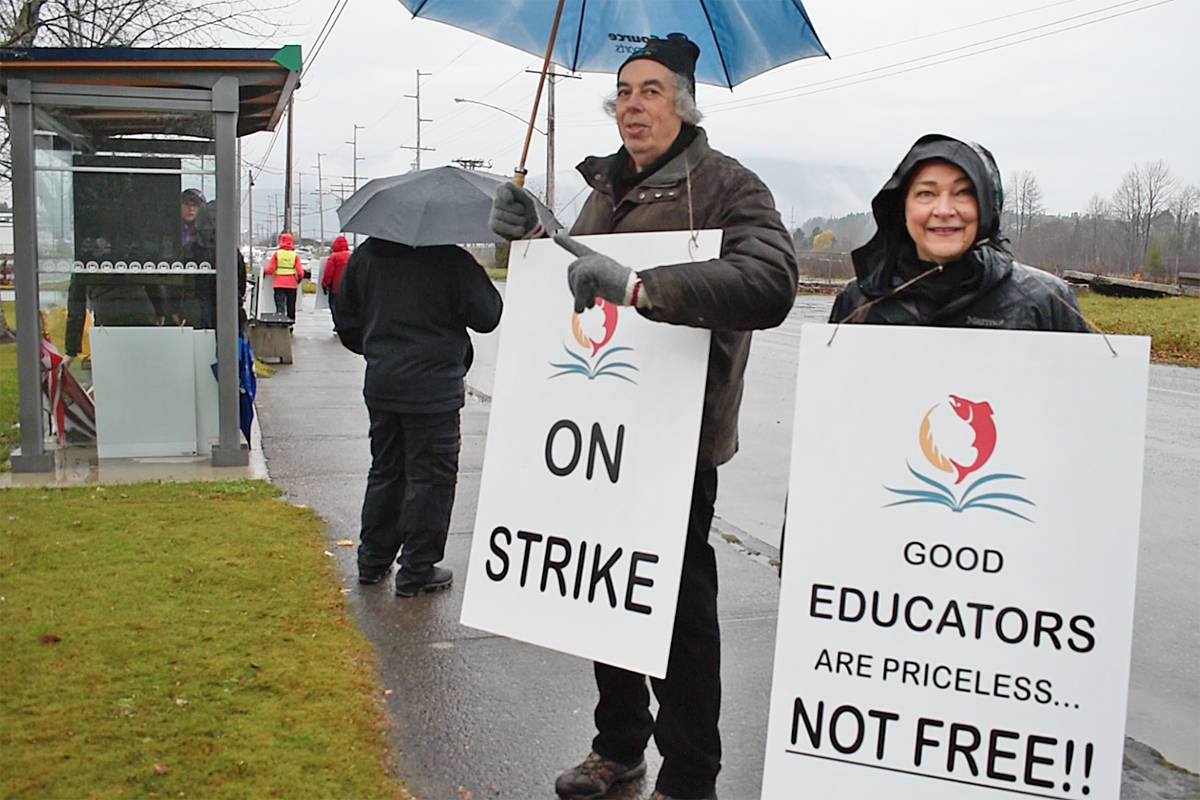 Protesters gathered outside the Terrace UNBC campus at 7:30 a.m. on Nov. 7, carrying signs reading 'Good educators are priceless, not free' and 'On strike.' (Brittany Gervais/Terrace Standard)