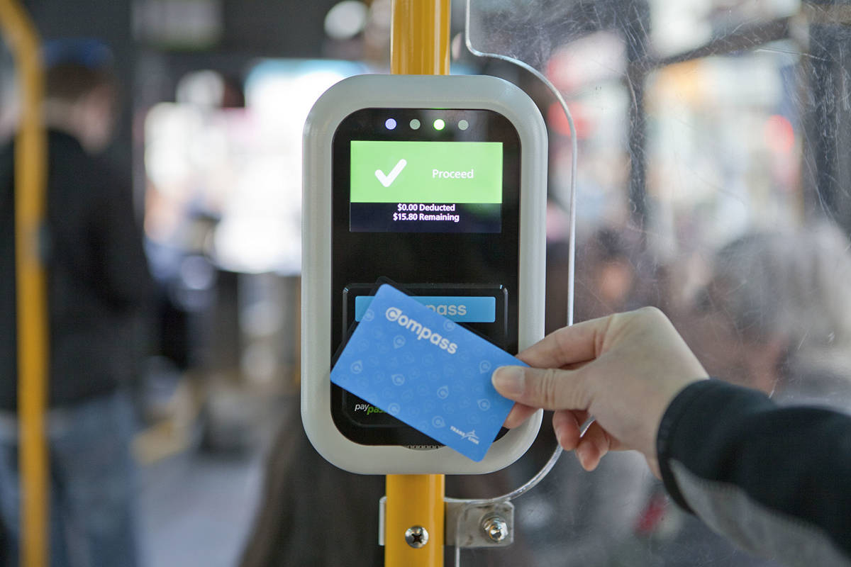 A rider pays for a bus with their TransLink compass card in Metro Vancouver. (GoToVan/Flickr, Creative Commons 2.0)