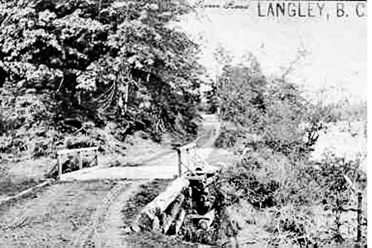 "This photos from about 1910 and has a caption in red ink on the back that says ""Around the bluff on River Road (West Creek) Ft. Langley"". (Langley Centennial Museum collection 000577)"