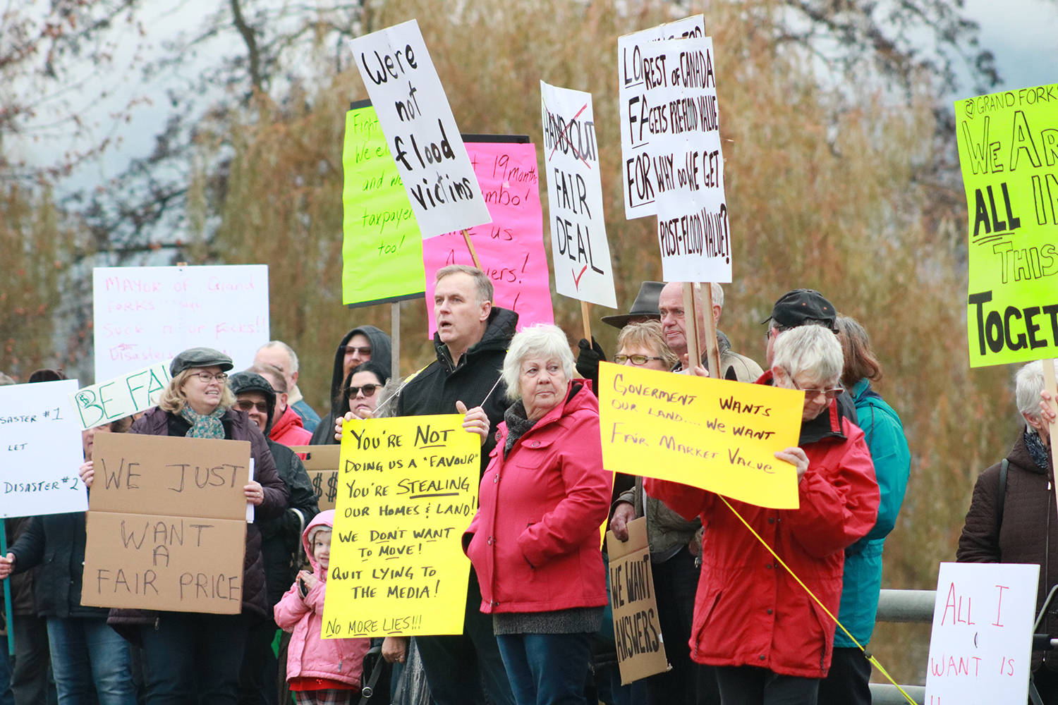 """Grand Forks residents rally on Nov. 15 to raise awareness about the flood buyout process and to ask for """"a fair deal.""""                                (Jensen Edwards/Grand Forks Gazette)"""