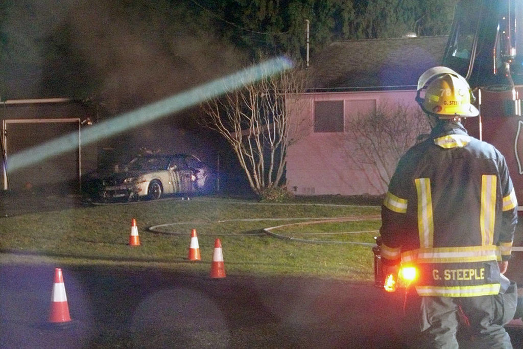 A vehicle suffered extensive damage in an early morning fire that damaged a house in Brookswood Saturday morning (Nov. 16). (Dan Ferguson/Langley Advance Times)
