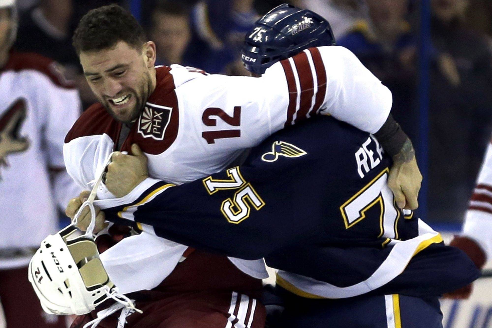Phoenix Coyotes' Paul Bissonnette (12) and St. Louis Blues' Ryan Reaves fight during the first period of an NHL hockey game on Thursday, April 18, 2013, in St. Louis. (AP Photo/Jeff Roberson)