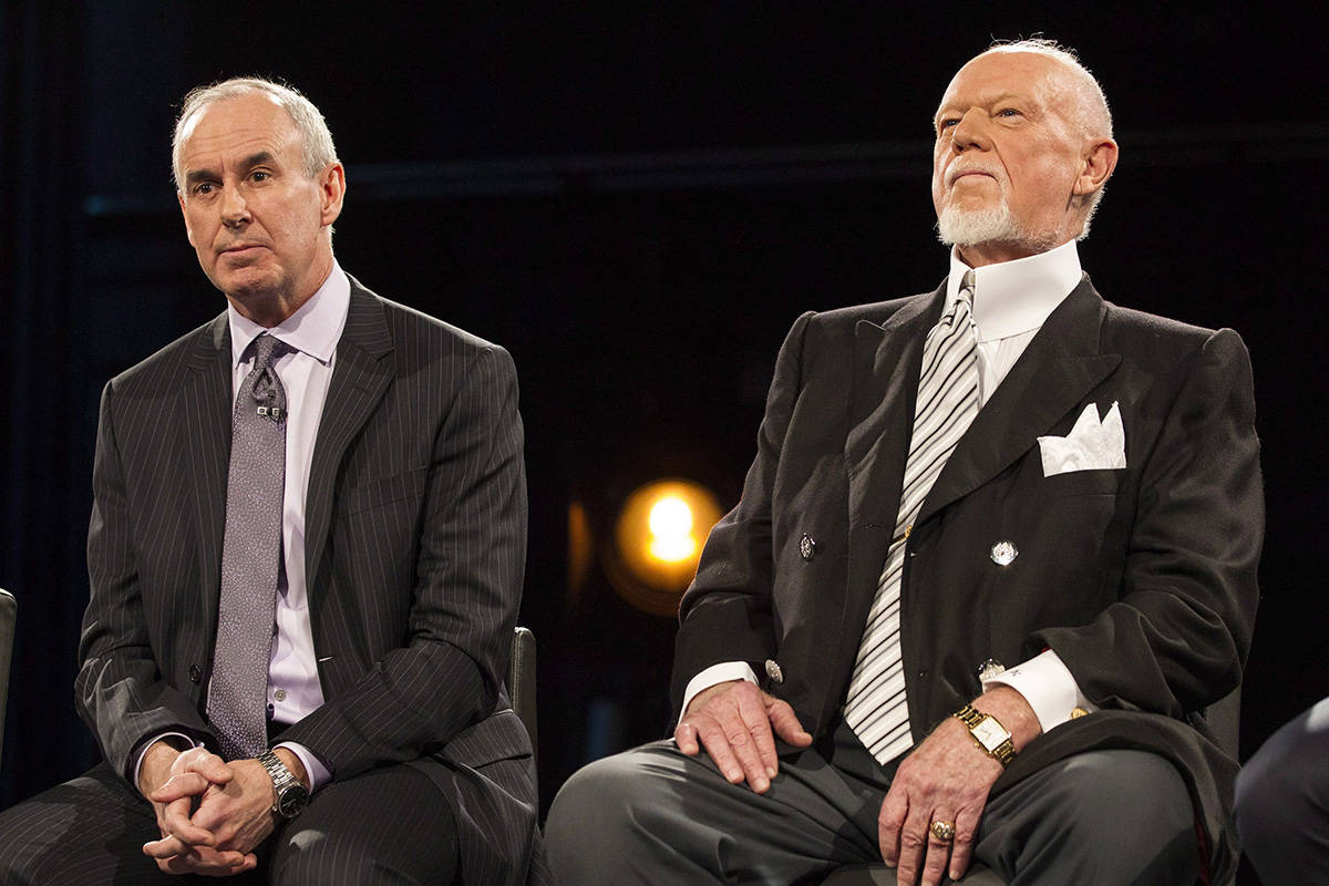 """Ron MacLean (left) sits beside Don Cherry as Rogers TV unveils their team for the station's NHL coverage in Toronto on Monday, March 10, 2014. MacLean addressed Don Cherry's dismissal during the first intermission of Saturday's """"Hockey Night in Canada"""" broadcast. THE CANADIAN PRESS/Chris Young"""