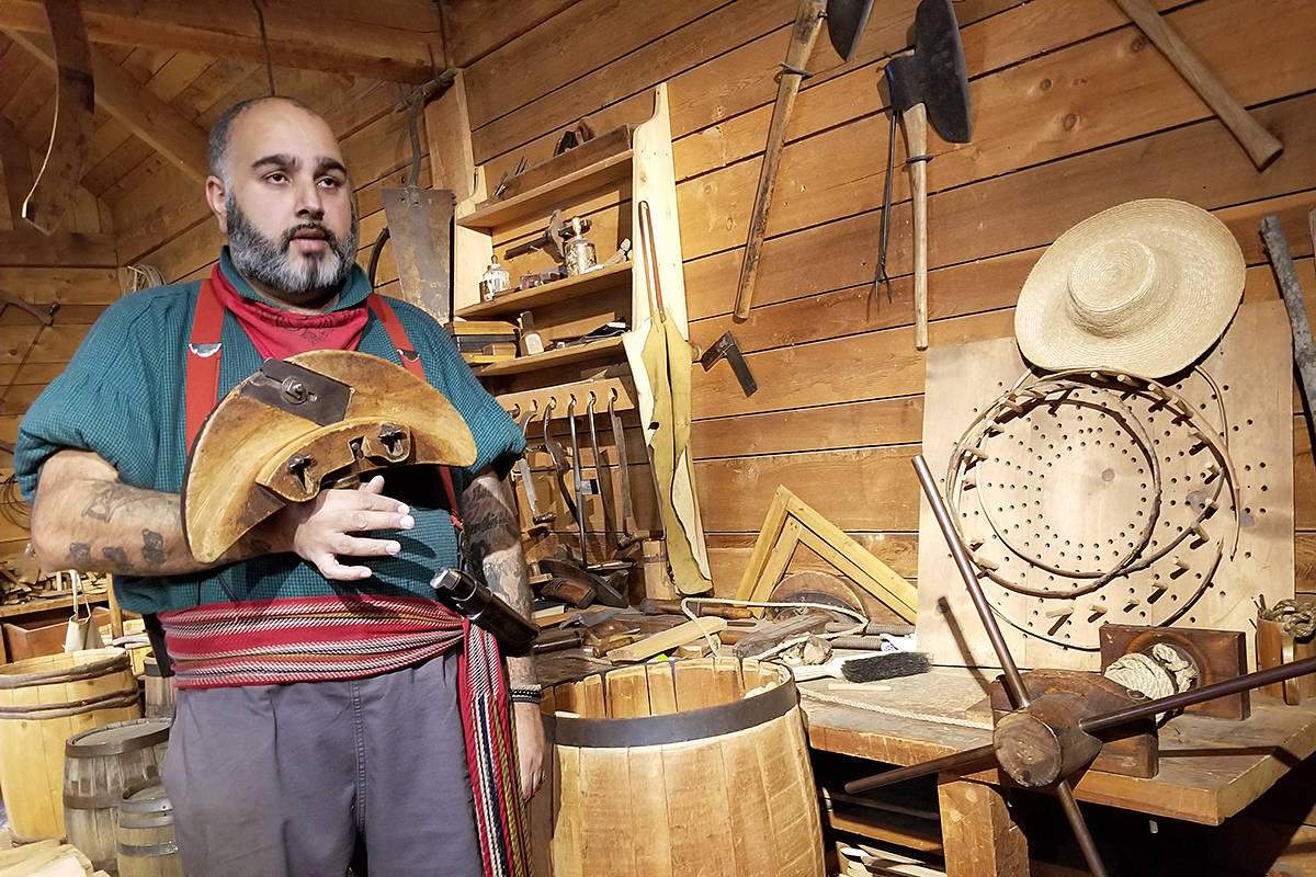 In order to teach visitors about the lost art of barrel making at historic Fort Langley, staffer Aman Johal built one himself in the fort cooperage using traditional hand tools. (Dan Ferguson/Langley Advance Times)