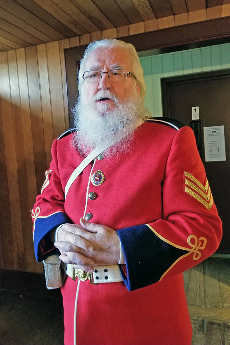 Historical re-enactor Graham MacDonell explained how the RCMP adapted their trademark red serge from the British military. (Dan Ferguson/Langley Advance Times)