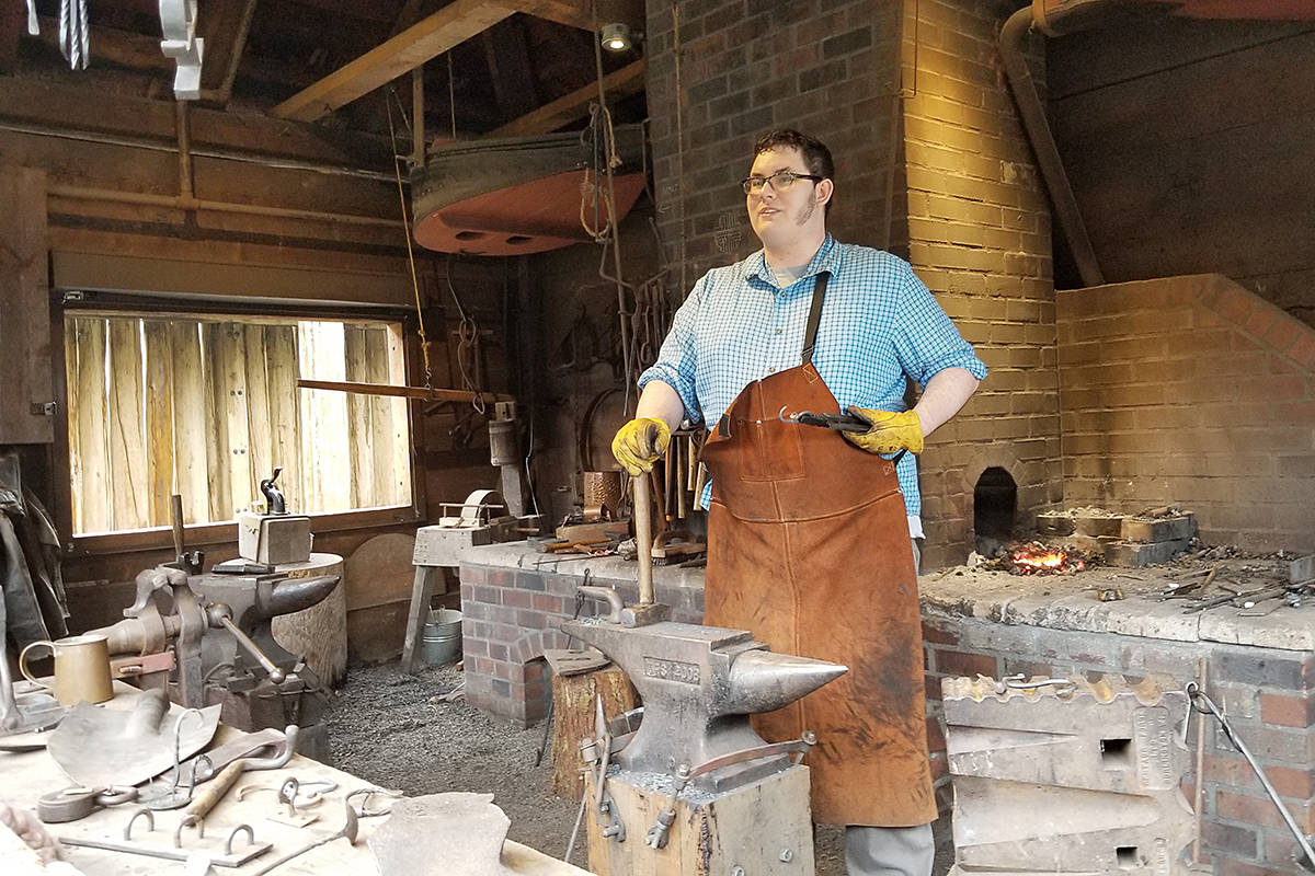 A blacksmith was playing his trade. (Dan Ferguson/Langley Advance Times)
