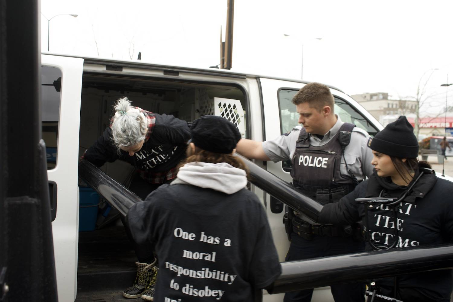 RCMP cut free activists chained to Kelowna bank, placed under arrest