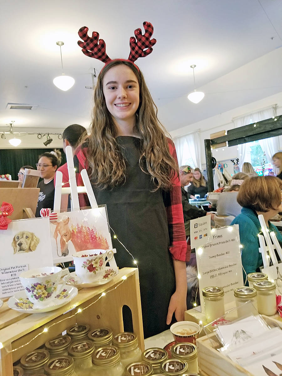 Grace Abbot, 14, of Fort Langley was selling candles and her own original artwork with partial proceeds going to the Horse Protection Society of B.C. The Langley Fine Arts student was one of several vendors taking party in the Thinking Generously craft fair and fundraiser, on Sunday, Nov. 17 at the Fort Langley community hall. (Dan Ferguson/Langley Advance Times)