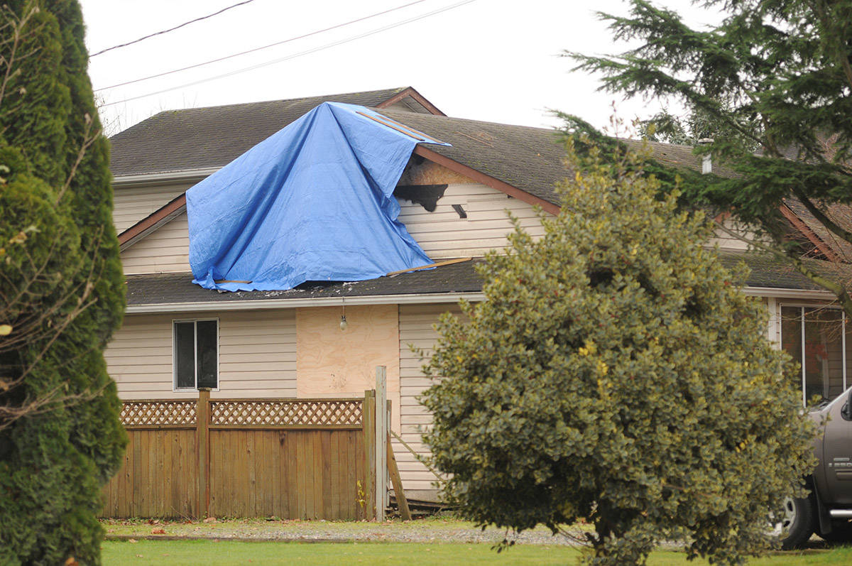A tarp covers part of a house on Ashwell Road in Chilliwack where a fire broke out on Saturday night. (Jenna Hauck/ The Progress)