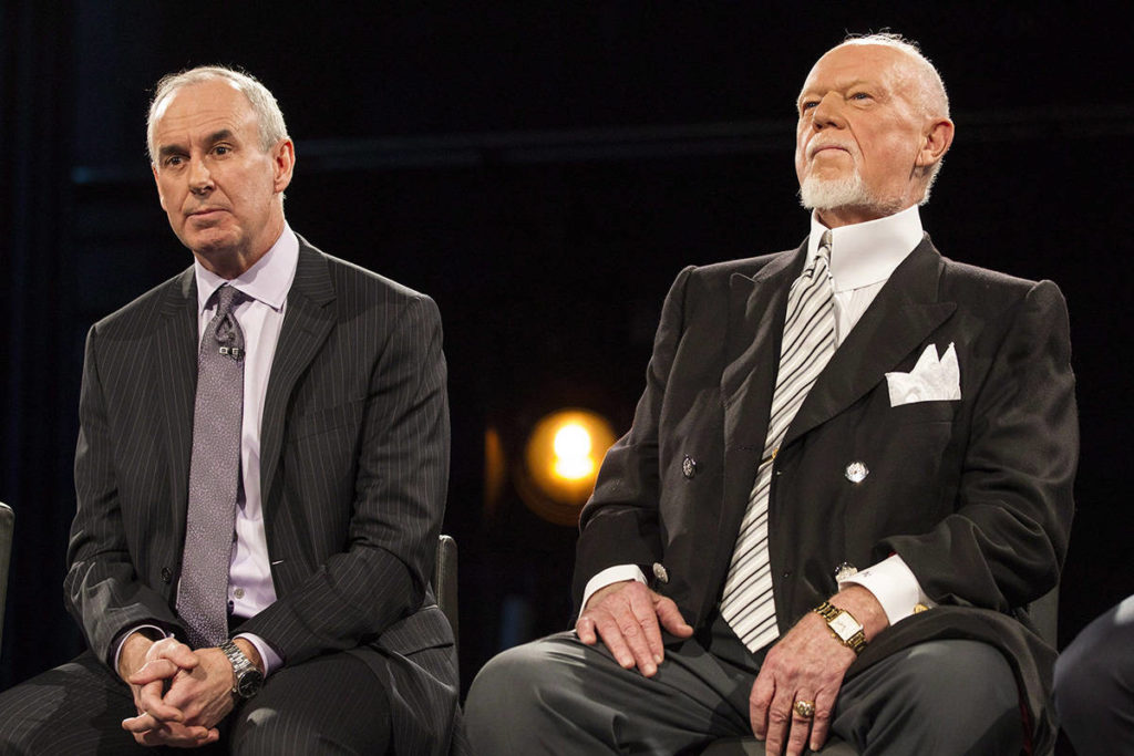 "Ron MacLean (left) sits beside Don Cherry as Rogers TV unveils their team for the station's NHL coverage in Toronto on Monday, March 10, 2014. MacLean addressed Don Cherry's dismissal during the first intermission of Saturday's ""Hockey Night in Canada"" broadcast. THE CANADIAN PRESS/Chris Young"