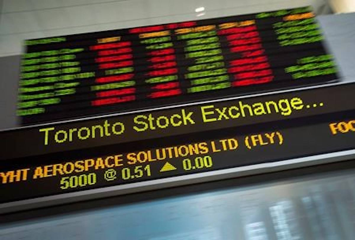 Financial numbers flow on the digital ticker tape at the TMX Group in Toronto's financial district on May 9, 2014. THE CANADIAN PRESS/Darren Calabrese