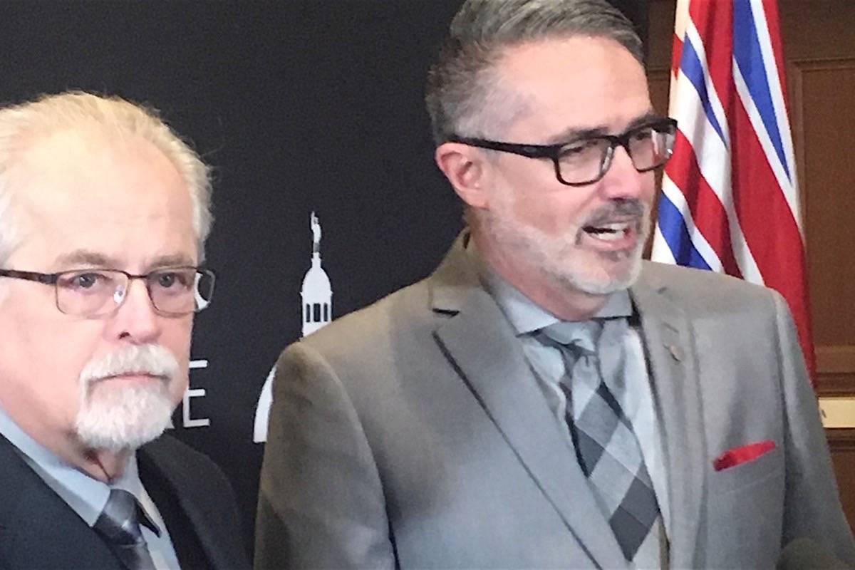 School bus driver Gary Lillico and Chilliwack-Kent MLA Laurie Throness speak to reporters at the B.C. legislature Monday. (Tom Fletcher/Black Press)