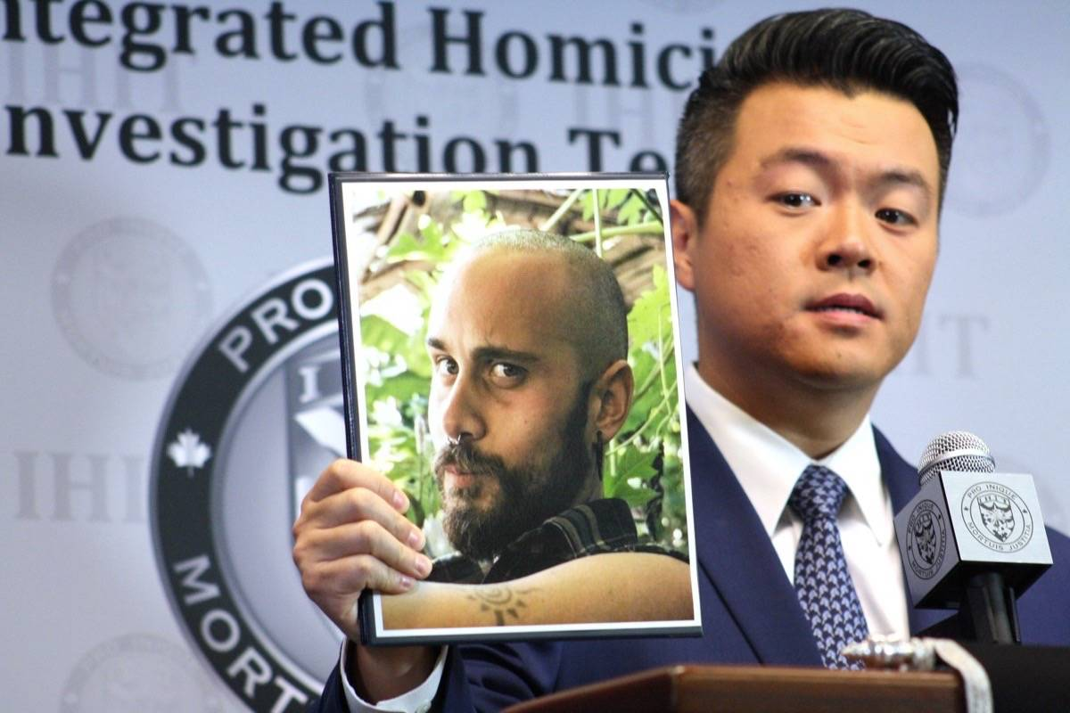 IHIT Cpl. Frank Jang holds up a photo of Sean McKenzie, 27, who pleaded guilty to the second-degree murder of Belgian tourist Amelie Sakkalis, 28, near Boston Bar on Aug. 22, 2019. (Katya Slepian/Black Press Media)