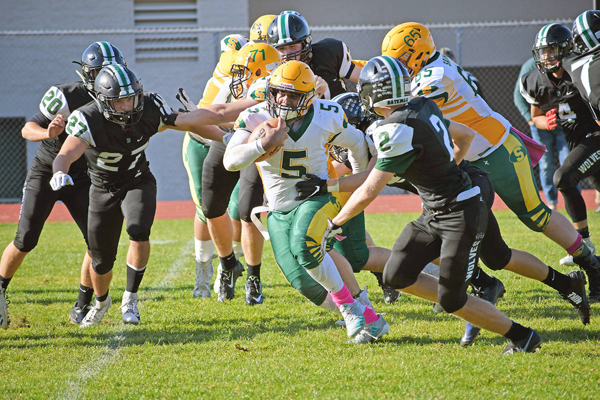 Saints fullback Harshaad Jouhal, seen here earlier in the season, had three touchdowns Saturday as the LSS senior varsity team moved a game closer to the Subway Bowl (Katie Burt/special to Langley Advance Times)