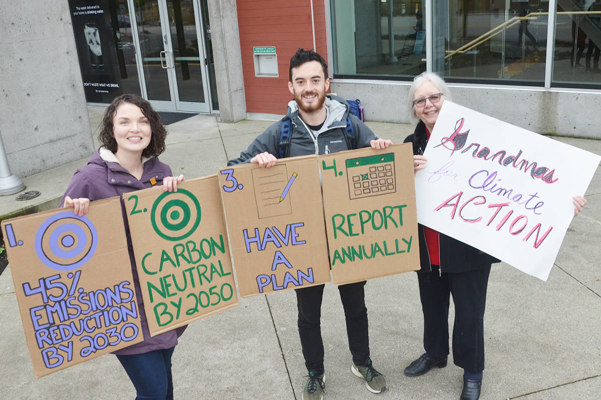 Cheryl Wiens, Isaac Beevor, and Marilyn Fischer were outside Township hall advocating for a carbon budget in advance of a council vote on Monday, Nov. 18. (Matthew Claxton/Langley Advance Times)