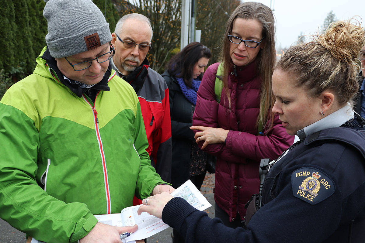 Jamie Hilland (left), Derek McCracken, Geraldine Jordan and Cst. Heather McLaren participated in a walkabout on Tuesday at Topham Elementary to identify and improve road safety. (Joti Grewal/Langley Advance Times)