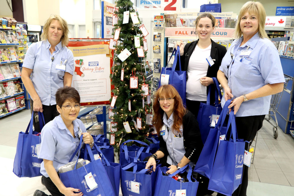 London Drugs staff Joanne Reynolds (from left), Tyra Gall, Michele Materi-Baker, Tate Wiggin and Peggy Price display some of the bags of Stocking Stuffers for Seniors that were donated last year for Vernon and area residents. Those interested in brightening Christmas for some of the 150 seniors can visit the store and pick a tag off the tree and return their donations by Dec. 10. (Jennifer Smith - Morning Star)
