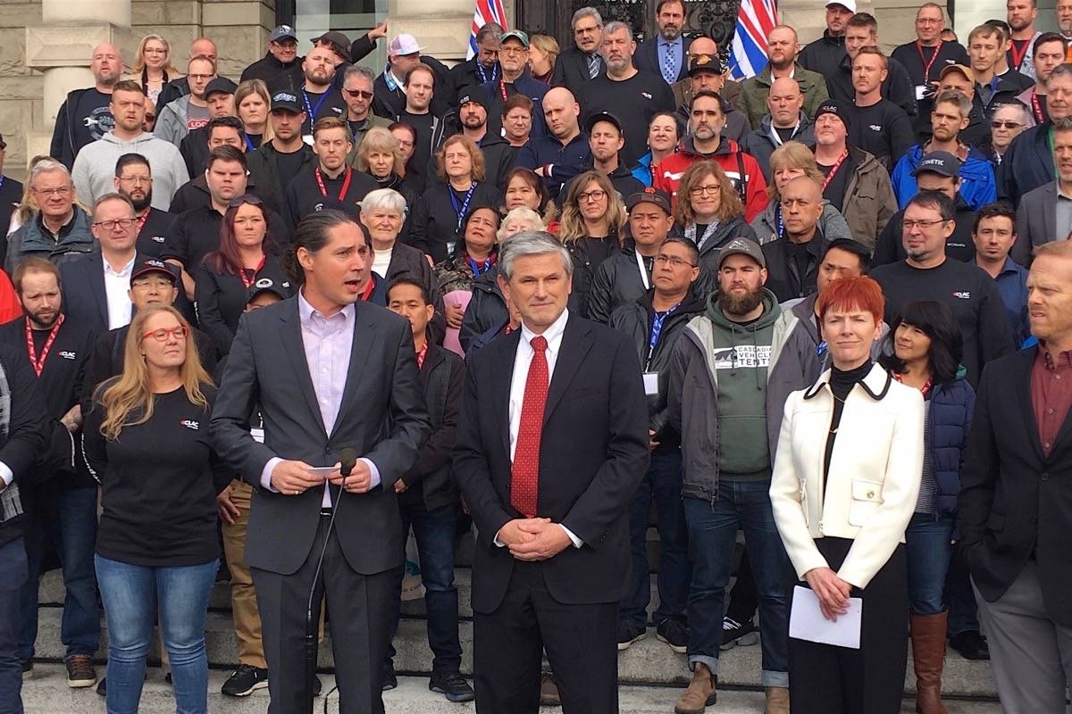 CLAC representative Ryan Bruce (left) introduces B.C. Liberal leader Andrew Wilkinson and Vancouver Regional Construction Association president Fiona Famulak to speak at rally with workers at the B.C. legislature, Nov. 19, 2019. (Tom Fletcher/Black Press)