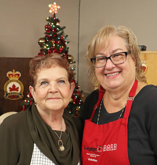 The Aldergrove legion ladies auxiliary (LA) zone leader Barb Clease (left) and president Barb Burkett (right) were a few of the group members who worked their third annual Christmas market Sunday. (Sarah Grochowski photo)