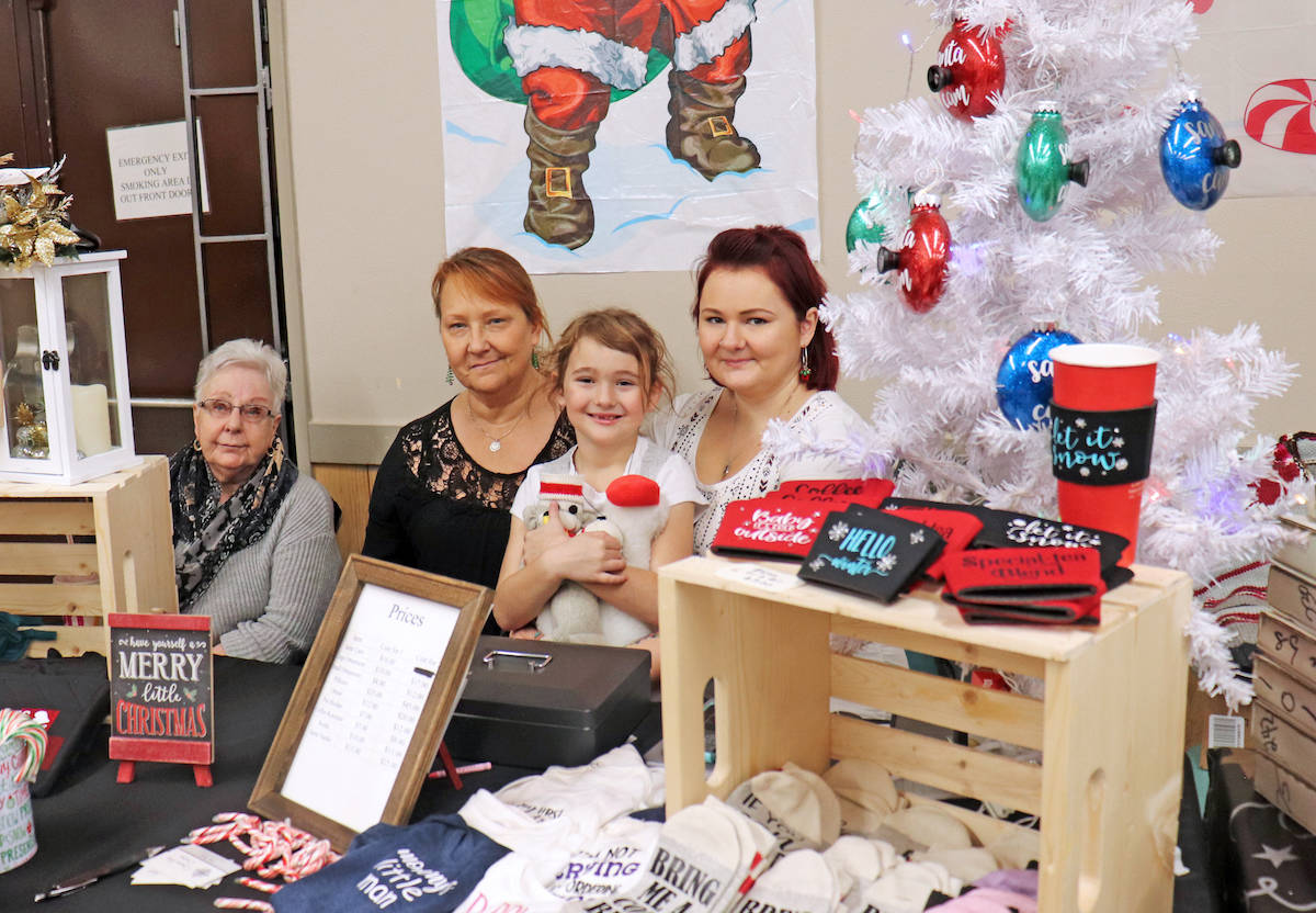 Alyenna Beales (middle) accompanied her grandmother Anne in selling handmade holiday creations alongside her mother and great grandmother on Sunday. (Sarah Grochowski photo)