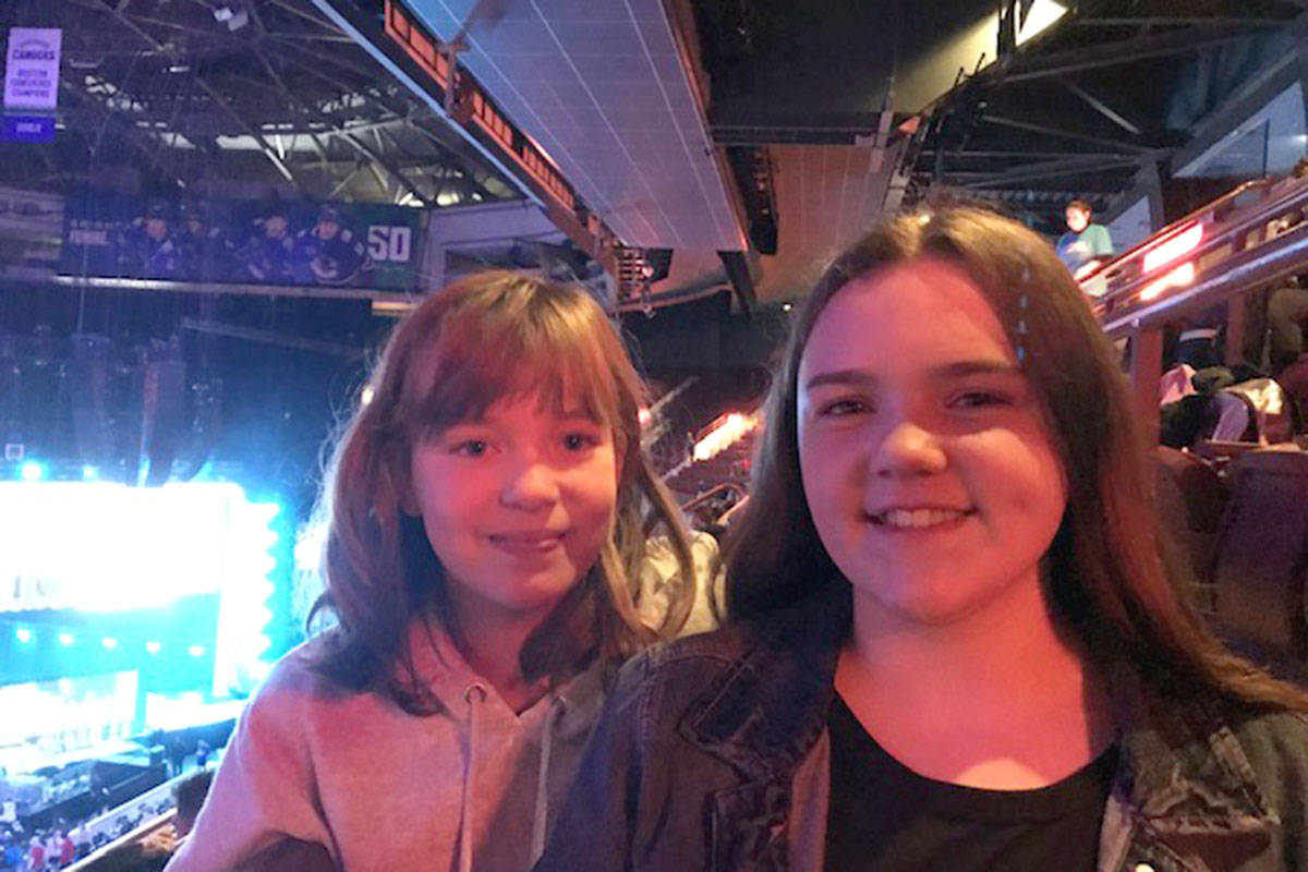 Malea Schapp (left) and Grace Farquharson were two of the students selected from Belmont Elementary to attend We Day in Vancouver. (Lisa Farquharson/Special to the Langley Advance Times)