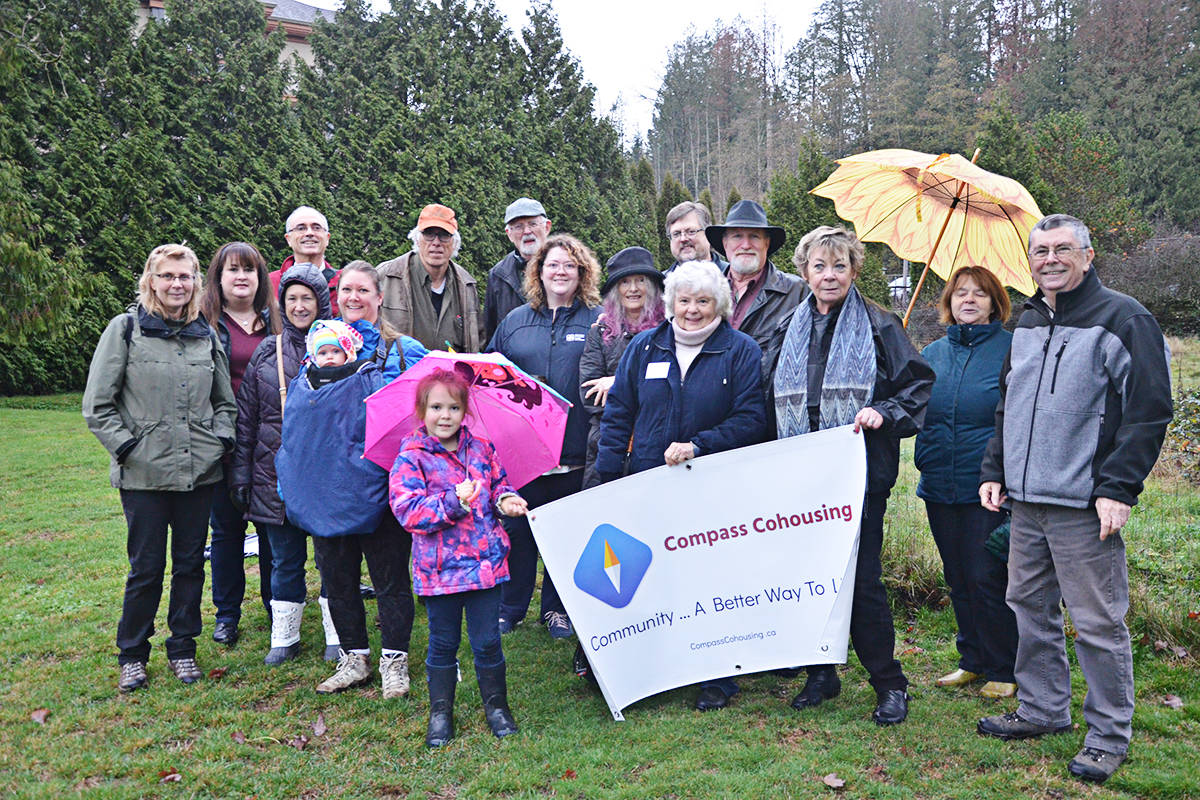 Members of the Compass Cohousing group checked out the land they hope to buy last week, where they want to build a 34-37 unit complex. (Matthew Claxton/Langley Advance Times)